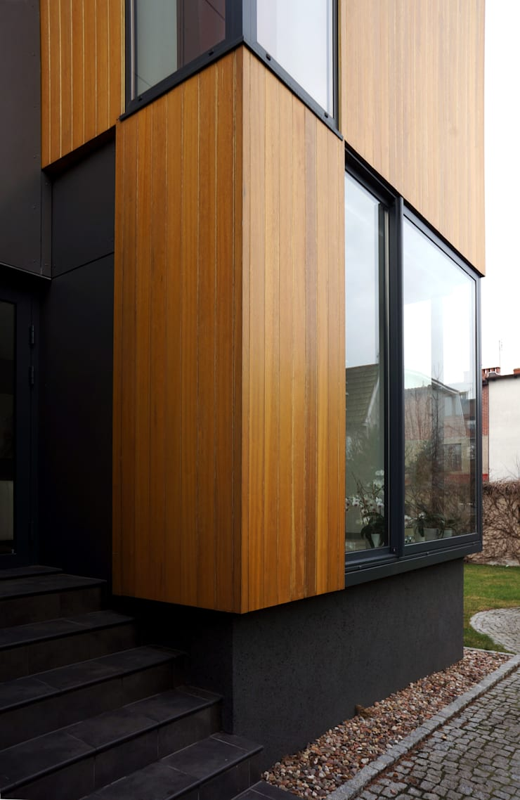 Rozbudowa domu: styl , w kategorii Domy zaprojektowany przez Grid Architekci ,