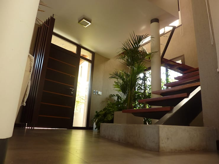 Interior: Pasillos, vestíbulos y escaleras  de estilo  por ADUO arquitectos