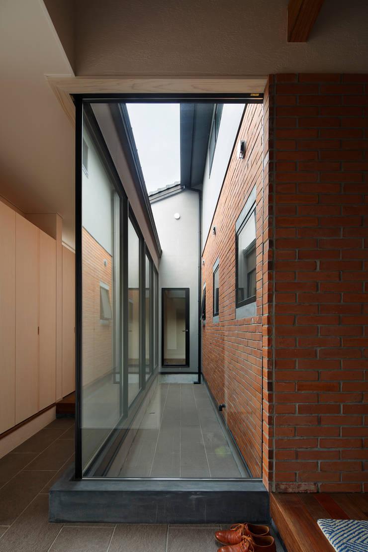 菊陽の家: アートレ建築空間 一級建築士事務所が手掛けた庭です。