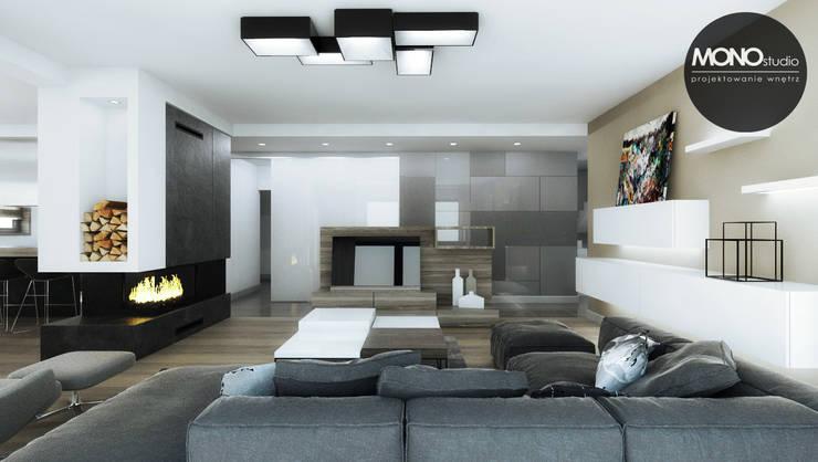Klimatyczne wnętrz w nowoczesnym domu w Krakowie: styl , w kategorii Salon zaprojektowany przez MONOstudio