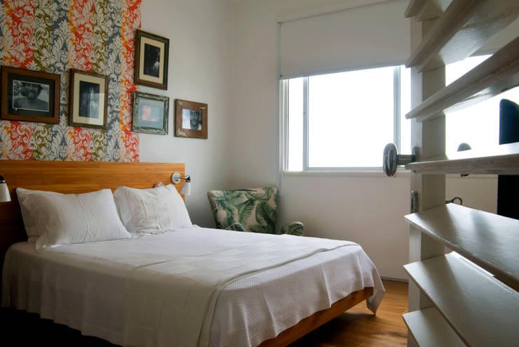 Apartamento Arpoador: Quartos  por Bel Castro Arquitetos