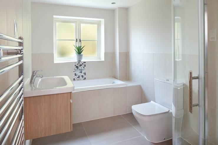 Baños de estilo  por Emma & Eve Interior Design Ltd, Moderno