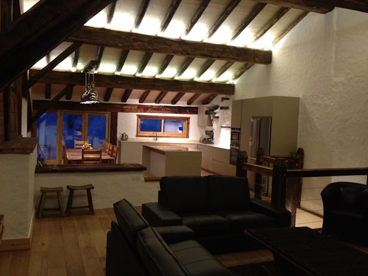 Val D'isere France:  Living room by CasaNora, Rustic
