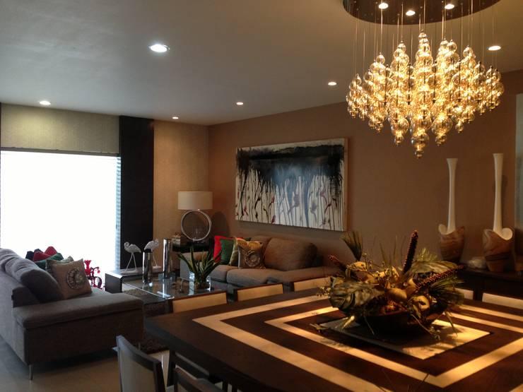 casa 319: Salas de estilo  por Hussein Garzon arquitectura