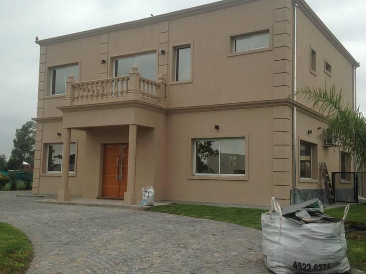 Haras de sta Maria: Casas de estilo  por NDT Constructores S.A,Clásico