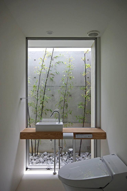 トイレ: 株式会社 空間建築-傳が手掛けた浴室です。