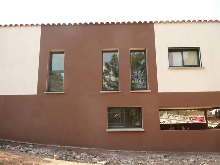 Vue façade: Maisons de style  par AGENCE D'ARCHITECTURE BRAYER-HUGON