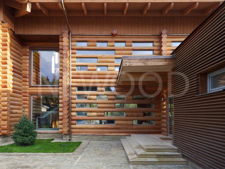 Projekty, klasyczne Domy zaprojektowane przez NEWOOD - Современные деревянные дома