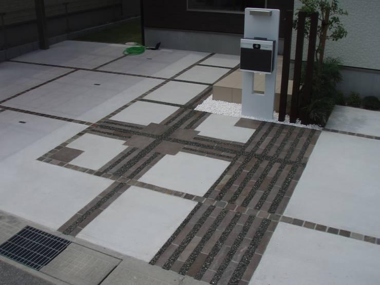 D様邸4: 山野興業 ガーデンスタイルなごみが手掛けた現代のです。,モダン