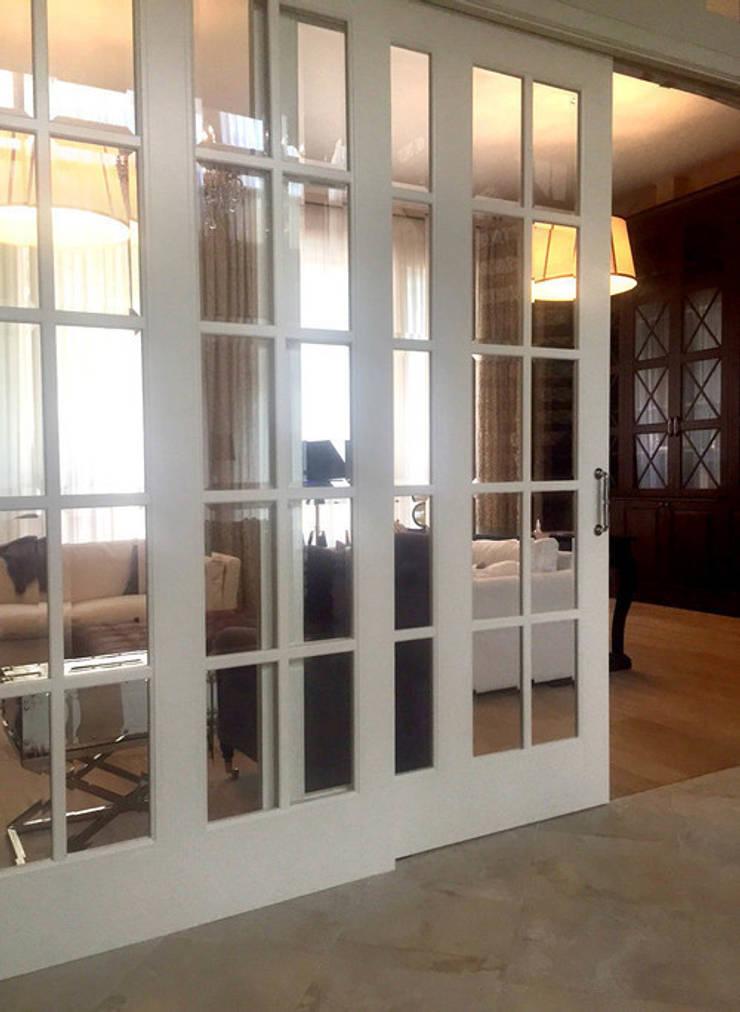 Фото раздвижных дверей: Гостиная в . Автор – Дизайн студия Ольги Кондратовой