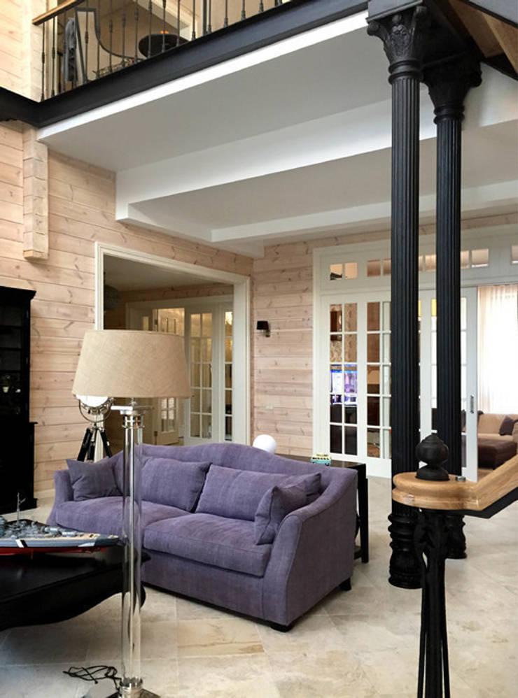 Интерьер гостиной с камином после ремонта по дизайн-проекту: Гостиная в . Автор – Дизайн студия Ольги Кондратовой