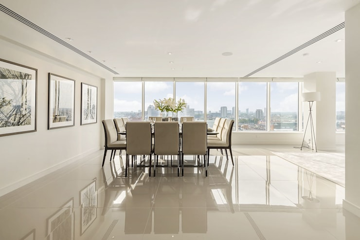 Large penthouse dining room with spectacular view over central London: modern Dining room by Porcel-Thin
