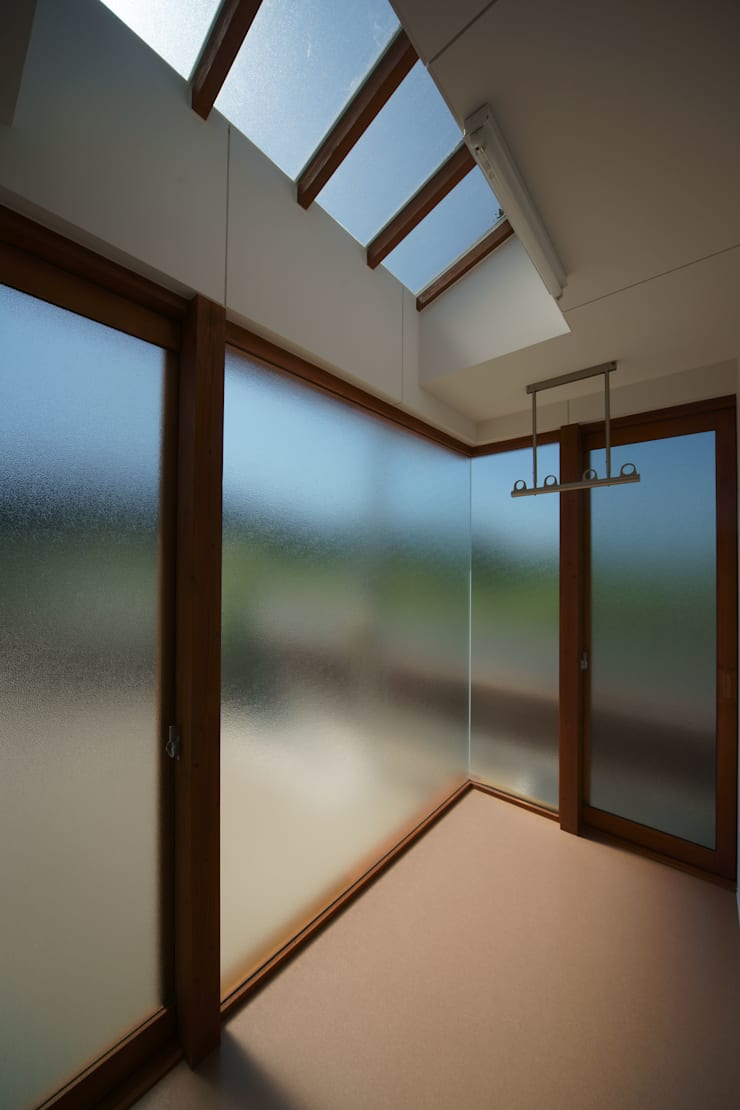 SMOOTH HOUSE: 株式会社プラスディー設計室が手掛けたベランダです。
