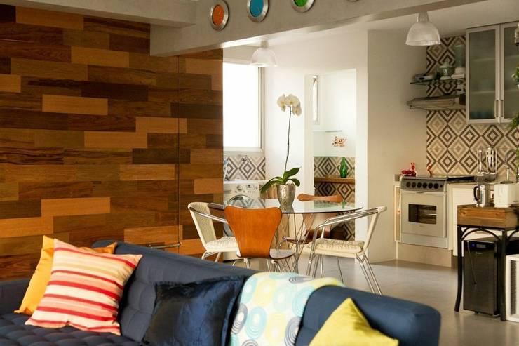 Aptº Higienópolis: Salas de jantar  por Boutique Arquitetura