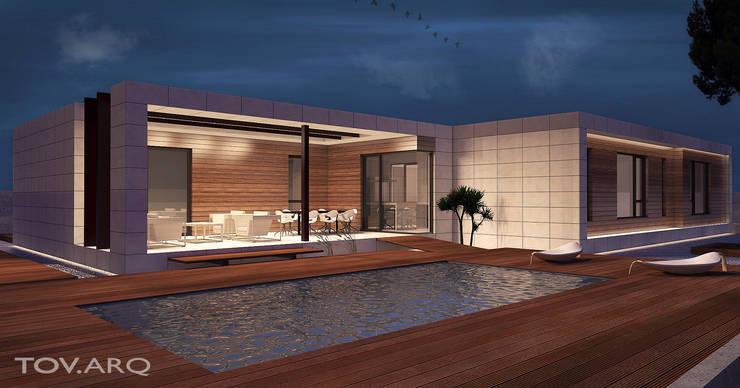 Vista nocturna de piscina: Casas de estilo minimalista de TOV.ARQ Estudio de Arquitectura y Urbanismo