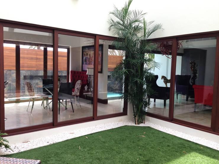 casa 240: Jardines de estilo  por Hussein Garzon arquitectura