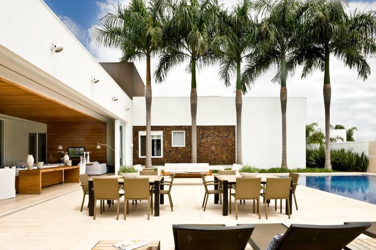 Casa Térrea: Terraços  por Ana Paula e Sanderson Arquitetura