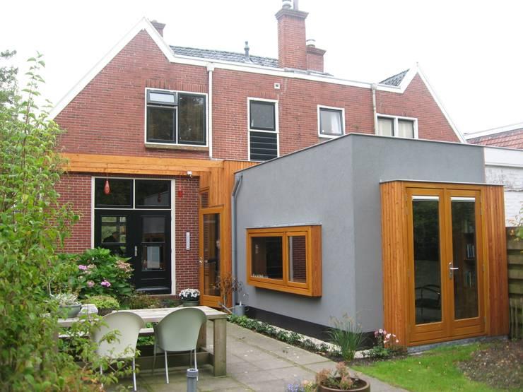 Verbouw woonhuis:  Huizen door Helder & Helder, Modern