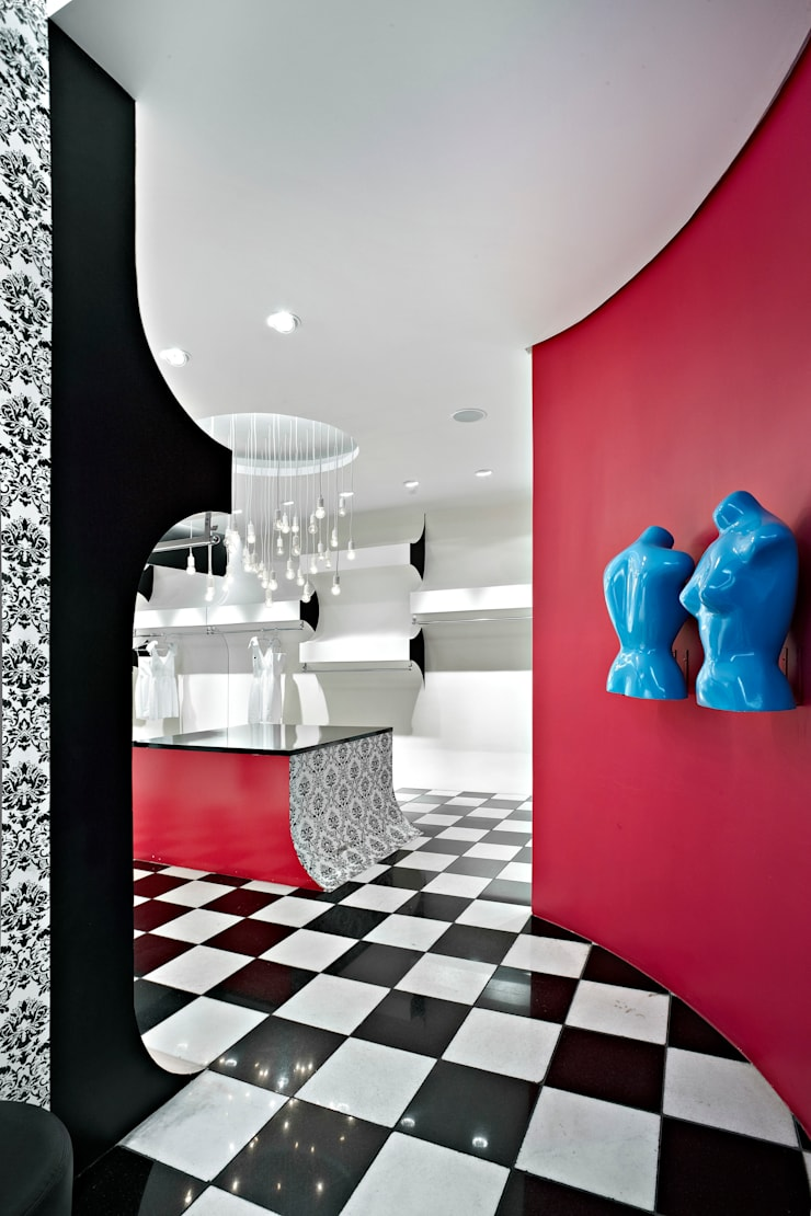 Showroom Karola: Lojas e imóveis comerciais  por lena pinheiro - interior design