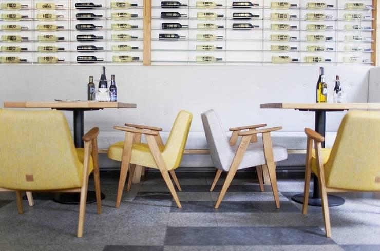 366 armchairs in a restaurant: styl , w kategorii  zaprojektowany przez 366 Concept Design & Lifestyle,Nowoczesny