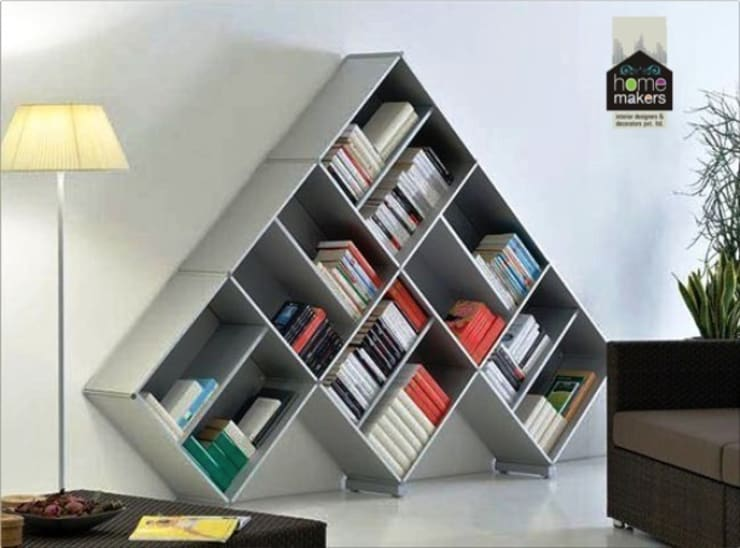 Bookstand:  Study/office by home makers interior designers & decorators pvt. ltd.