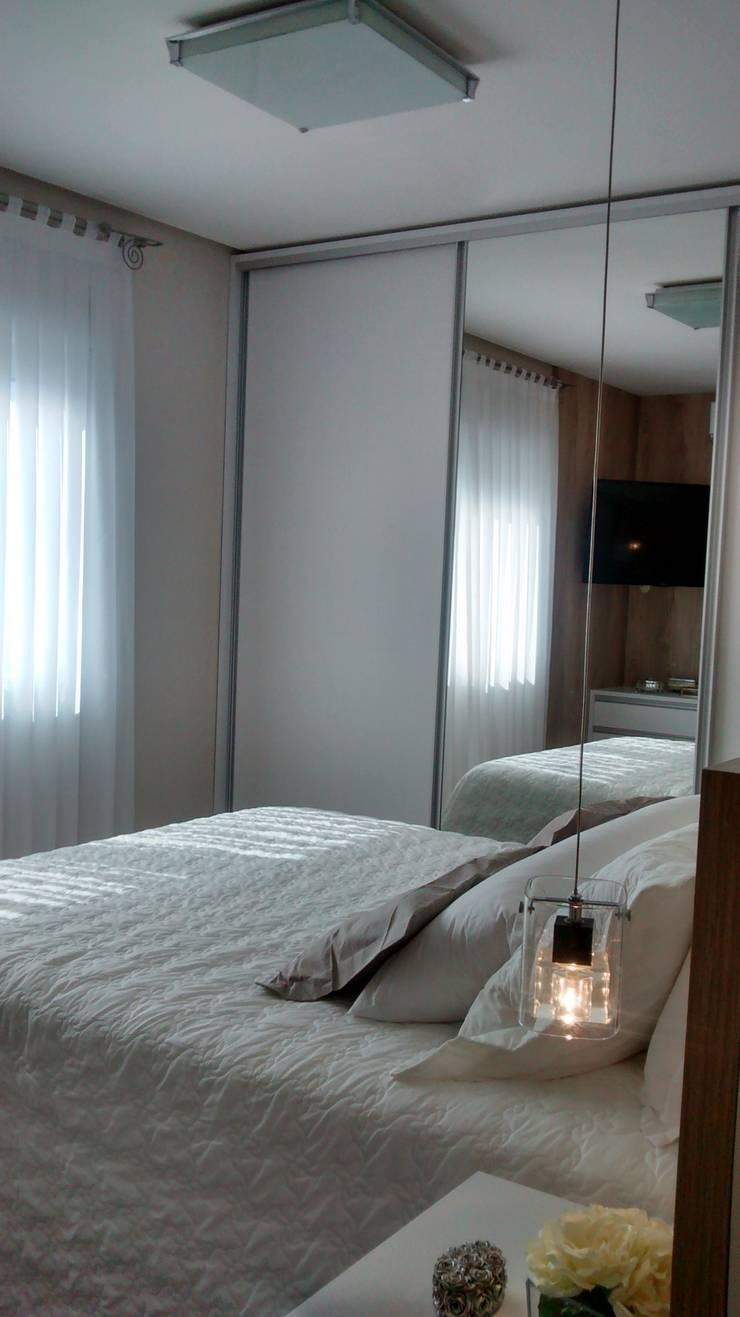 Apartamento : Quartos  por Daniela Coutinho Arquitetura e Interiores