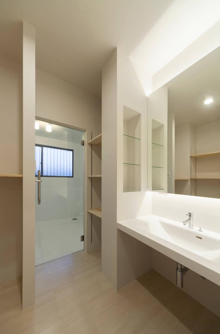 1階 ラバトリー: 松本勇介建築設計事務所 / Office of Yuusuke MATSUMOTOが手掛けたです。,