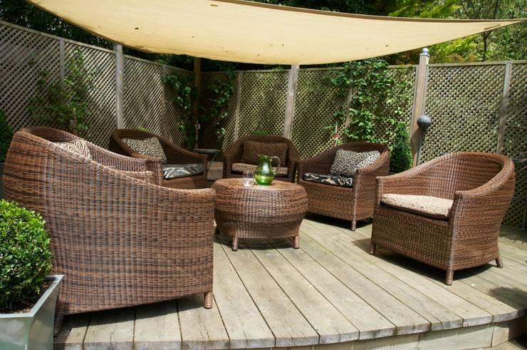 Jardines de estilo  por Lothian Design