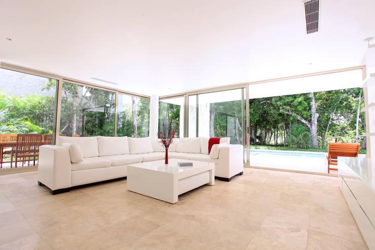 Casa T: Salas de estilo  por Enrique Cabrera Arquitecto