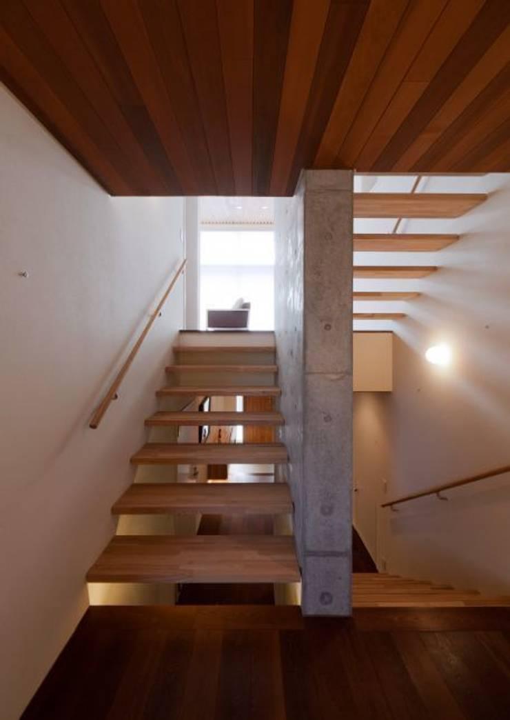 玉野台の家: 笹野空間設計が手掛けた廊下 & 玄関です。
