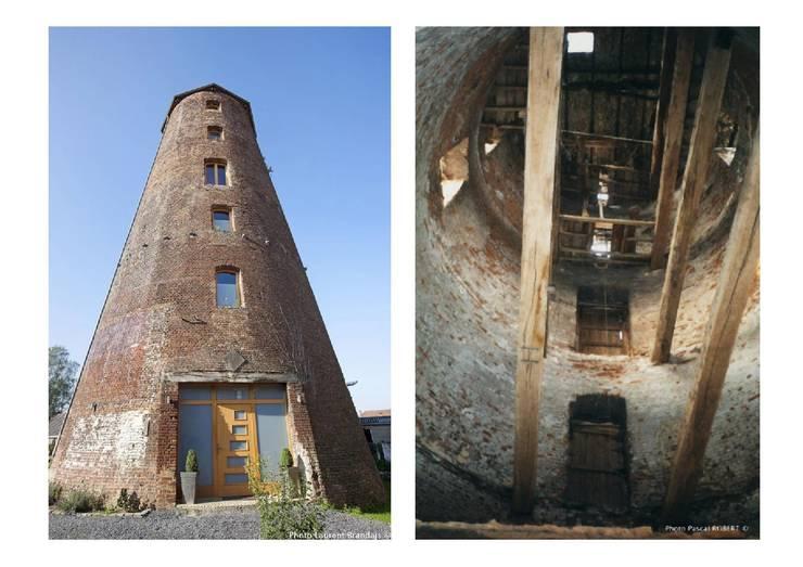 Réhabilitation d'un ancien moulin à vent en habitation - Hainaut - Belgique:  de style  par Draw&dO