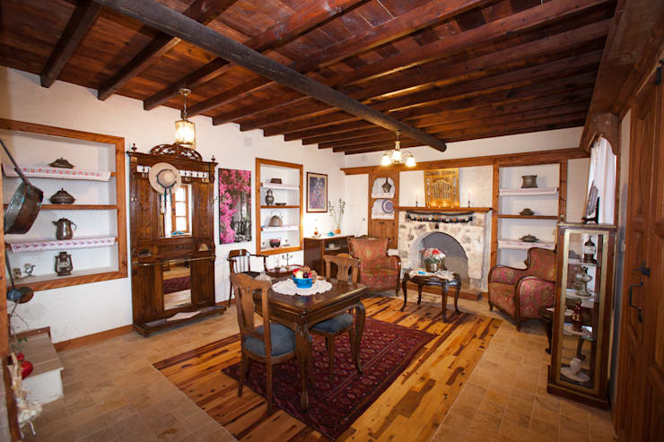 Salas de estilo  por Hoyran Wedre Country Houses