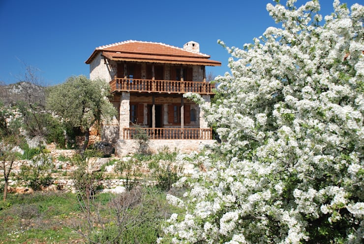 Projekty, śródziemnomorskie Domy zaprojektowane przez Hoyran Wedre Country Houses