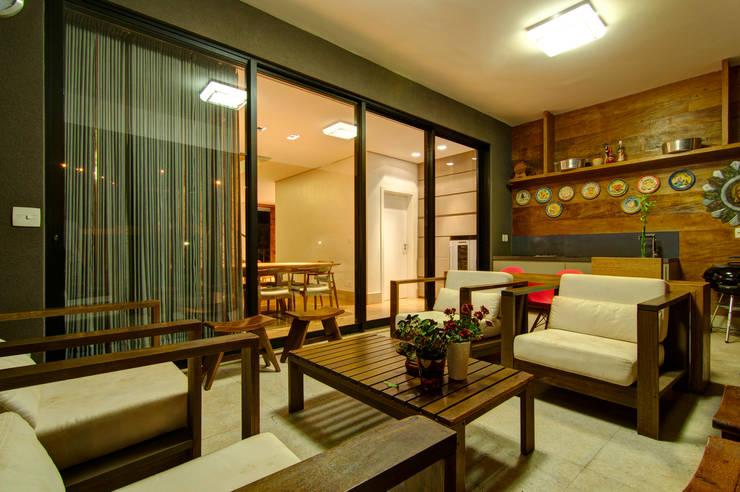Residência VG: Terraços  por ÓBVIO: escritório de arquitetura