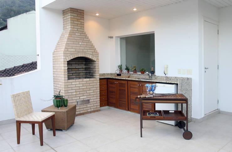 Churrasqueira cobertura Horto: Terraços  por Fernanda Leme Arquitetura e Design de Interiores