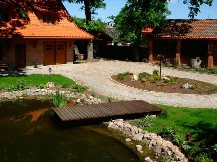 Prosty pomost: styl , w kategorii  zaprojektowany przez Garden Ekspert Studio Architektury Krajobrazu