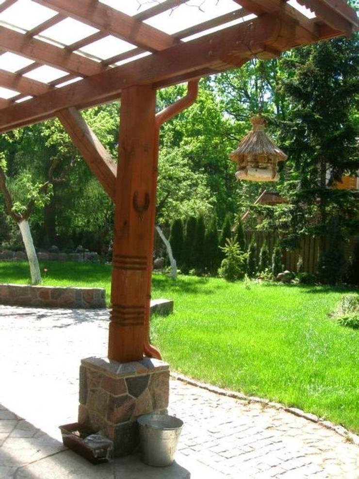 Karmik dla ptaków: styl , w kategorii  zaprojektowany przez Garden Ekspert Studio Architektury Krajobrazu