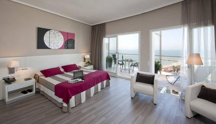 Habitación de hotel: Dormitorios de estilo moderno de Cuadrosmodernos.net