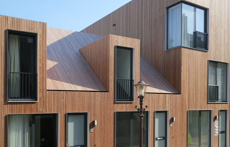 voorgevel:  Huizen door m3h architecten, Modern