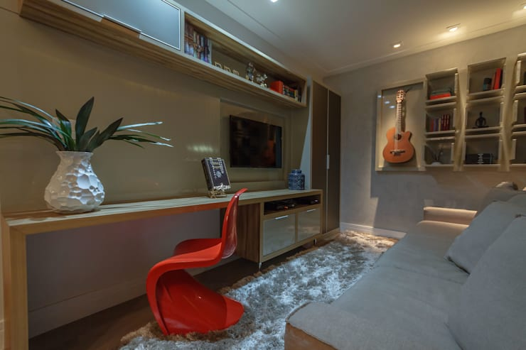 Apartamento em Belo Horizonte: Salas de multimídia  por Lívia Bonfim Designer de Interiores