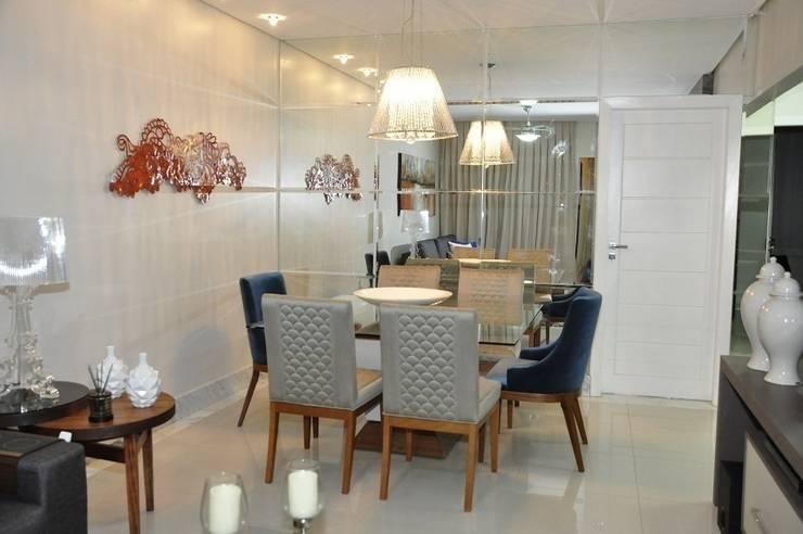 Apartamento Machacalis 2: Salas de jantar modernas por Lívia Bonfim Designer de Interiores