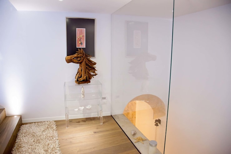 7 levels: Ingresso & Corridoio in stile  di G/G associati studio di ingegneria e architettura _ing.r.guglielmi_arch.a.grossi