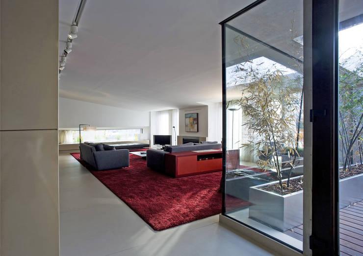 Salones de estilo  de RRJ Arquitectos
