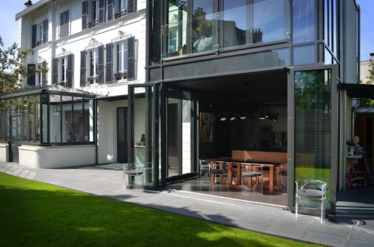 Volume-design: Jardin de style de style Moderne par volume