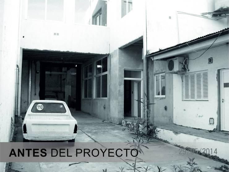INGRESO VEHICULAR ANTES DEL PROYECTO: Oficinas y locales comerciales de estilo  por D'ODORICO OFICINA DE ARQUITECTURA