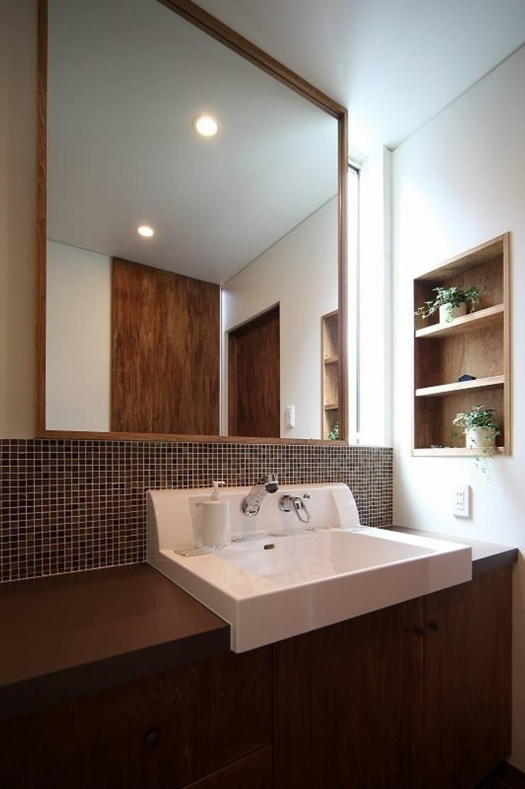 子供の成長を促す家 / zuiun: zuiun建築設計事務所 / 株式会社 ZUIUNが手掛けた浴室です。