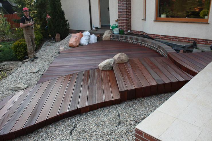 Taras drewniany. Realizacja w Wilkanowie koło Zielonej Góry.: styl , w kategorii  zaprojektowany przez PHU Bortnowski,Nowoczesny
