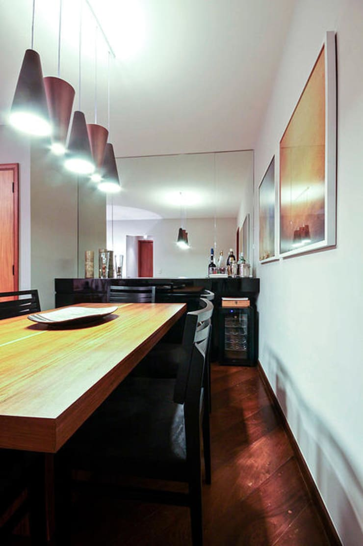 AP FT: Salas de jantar  por KFOURI ZAHARENKO arquitetura e design