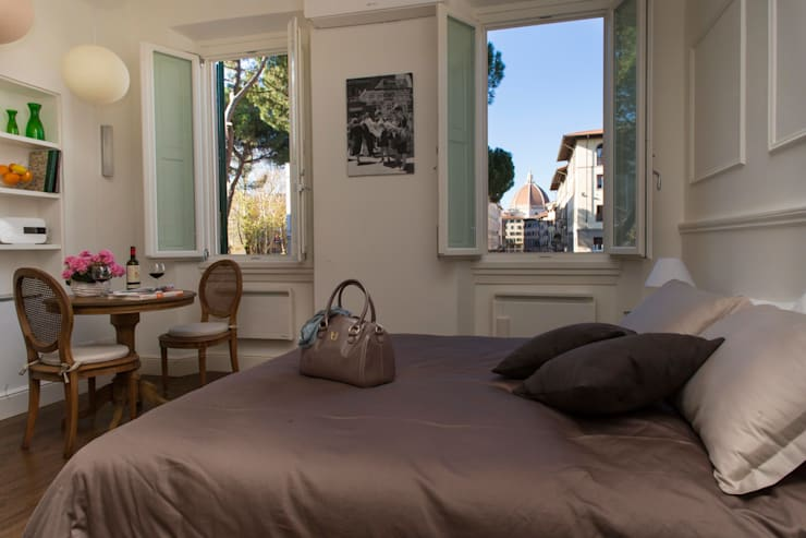 Ciompi Small House: Camera da letto in stile  di Patrizia Massetti
