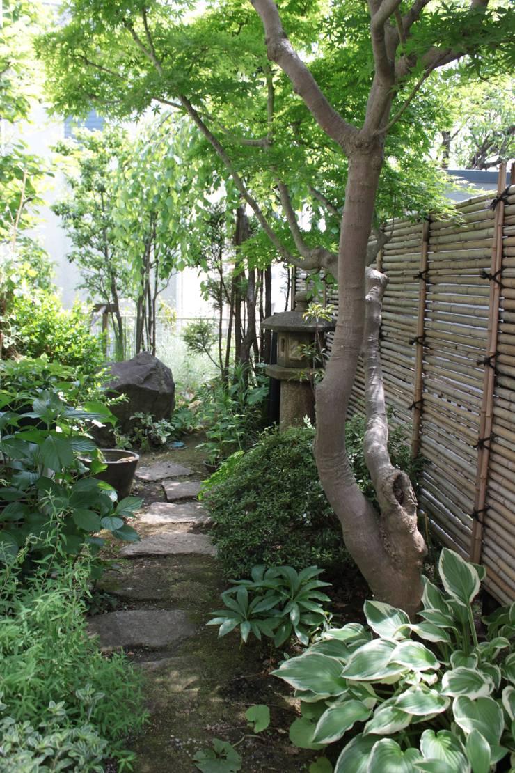 緑園都市の庭: 株式会社ムサ・ジャパン ヴェルデが手掛けた庭です。